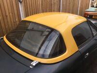 Mazda Mx5 yellow hardtop