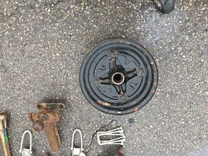 "Vintage 14"" trailer wheel and brake drum."