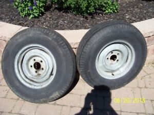 TWO USED GALVANIZED 14 INCH BOAT TIRES