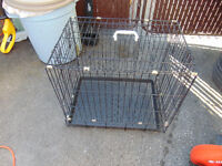 1 small dog cage 24x17x21 with small food and water bowls. do n