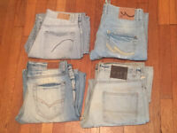 4 pairs of worn men's sandblasted jeans for sale