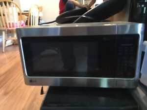 Two stainless steel microwave