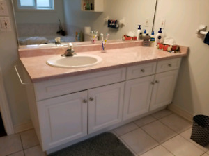 Cabinet with sink and faucet