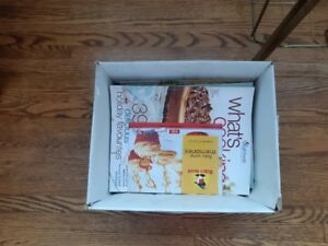 box of cooking magazines and cookbooks