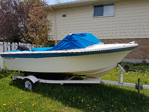 16 Foot Fibreglass boat with 70hp motor and trailer.