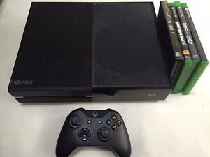 Xbox One with 4 games for sale.