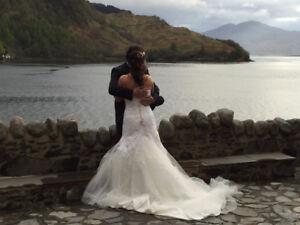 Beautiful Wedding Dress  ( original purchase price $1,500 )