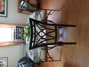 glass top dining table with 4 chairs.