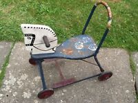 Old children's tin horse push along toy