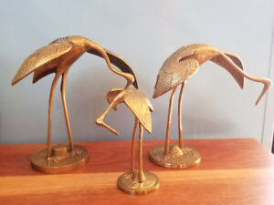Vintage set of three brass cranes