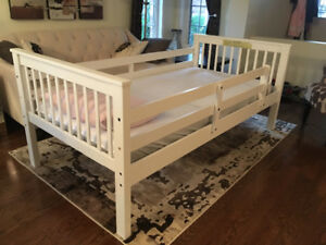 Single twin bed, white frame with thin mattress