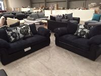 Brand new black leather with navy jumbo chord 3 + 2 seater sofa suite