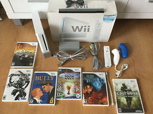 Console wii blanche - manette - nunshock - jeux - 110$