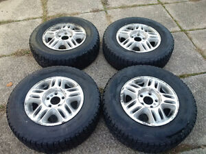 Set of four used Firestone Winterforce tires on alloy rims