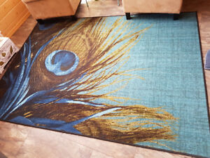 5 X 7 area rug.  Bright teal with peacock feather motif.