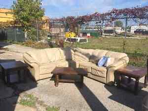 HIGH QUALITY TAUPE LEATHER SECTIONAL-REDUCED PRICE
