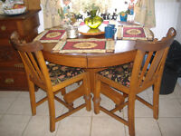 Antique solid oak round dining table and 4 carved oak chairs