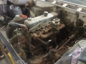 1960 Pontiac 261 6cyl engine and 3 speed manual trans.