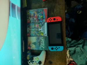 Selling Nintendo Switch +4Games,controller comes with box.