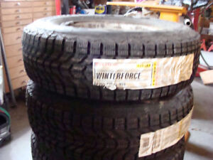 NEW NEVER USED    P205/75R 14 IN ON FORD RIMS  275.00 FIRM