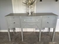A VINTAGE HAND PAINTED SIDEBOARD