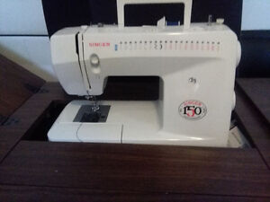 150th Anniversary Singer self threading sewing machine and desk