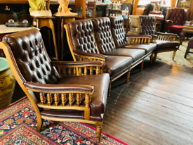 Brown leather buttoned back sofa and chairs