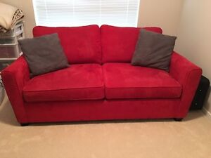 Red couch/ pull out bed