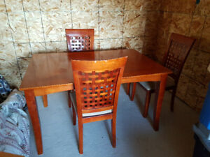 Two dining room tables with chairs