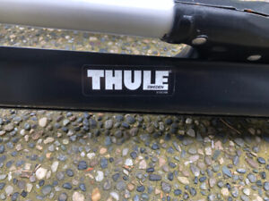 Thule roof top bike carriers. $50 each