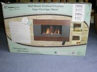 NEW NEVER USED WALL MOUNTED FIREPLACE WITH REMOTE CONTROL