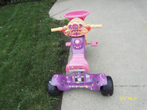 Girl tricycle with music.