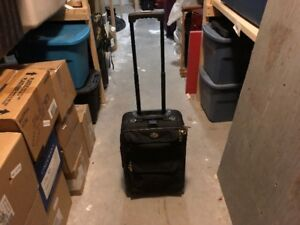 American tourister carry on rollaway luggage