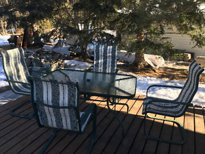 Patio glass table and 4 high back chairs (or best offer )