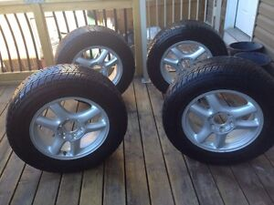 Winter tire on rims 17 inch Toyo tires