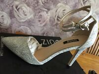 BRAND NEW SIZE 6 QUIZ SHOES SILVER