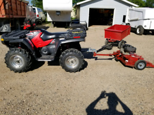 Polaris 4wd Quad with pull behind mower and dump trailer