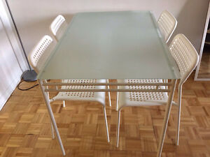 IKEA white glass table and 4 chairs