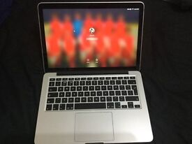 Brand New, Hardly Used Apple MacBook Pro.