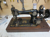 ANTIQUE HAND OPERATED SEWING MACHINE