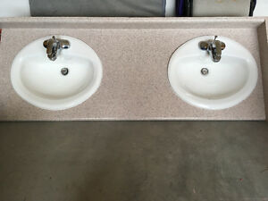 Dual vanity counter top with sinks