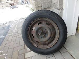 4 snow tires on steel rims - $150.00 - Tire size 185 65 R14