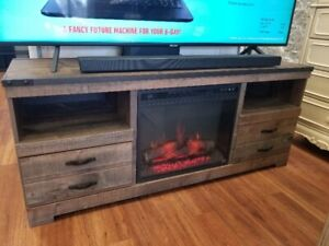 ASHLEY TRINELL FIREPLACE/TV STAND ONLY $250....WON'T LAST LONG!!