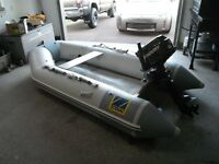10 ft inflatable Zodiac with motor for sale