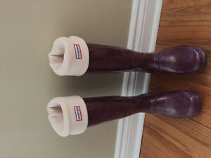 Plum colored Hunter boots with ivory colored liners