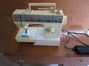 Singer Sewing Machine w/foot pedal and 2-drawer table