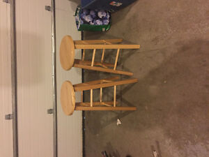 2 wooden bar stools.