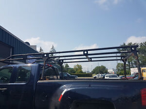 Reduced 500 Ladder rack off gmc adustable