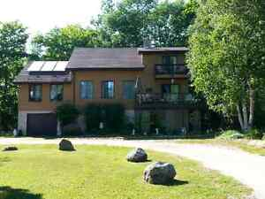"""REDUCED' 5 ACRES + YOUR OWN 4 SEASON RETREAT NEAR THE WATER"