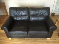 Brown/black two seater leather sofa